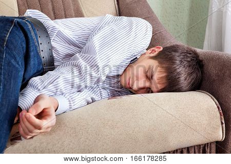 Tired Young Man sleep on the Sofa at the Home