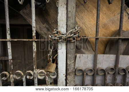 Locking metal door with chain and padlock photo taken in Jakarta Indonesia Indonesia java