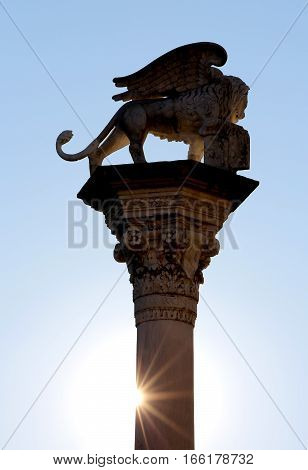 antique statue with winged lion symbol of the Serenissima Republic of Venice in Italy