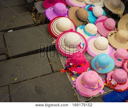 Pinky millinery and hats sold on the ground at Kota Tua Museum Area photo taken in Jakarta Indonesia java