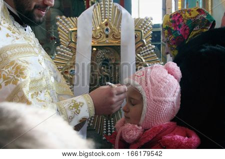 VOYUTYN UKRAINE - 08 January 2009: Orthodox priest commits the ceremony of the anointing at the celebration of a Christmas in the church