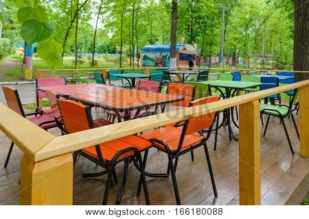 empty seats in a deserted park cafe
