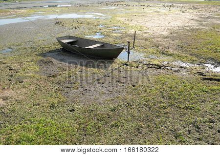 drought in the hot summer. Dried river and the boat on dry mud