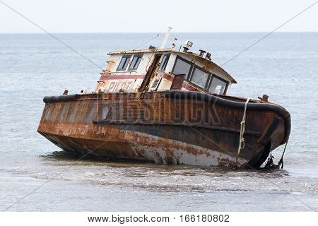 June 12 2016 Portobelo Panama: shipwreck on the rocks in the bay