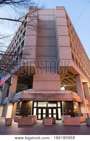 Washington DC, USA - December 29, 2016: FBI Federal Bureau of Investigation Headquarters on Pennsylvania avenue sign with American flags