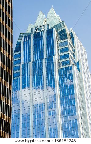Austin, USA - July 19, 2015: Frost Bank Tower skyscraper with pyramidal crown