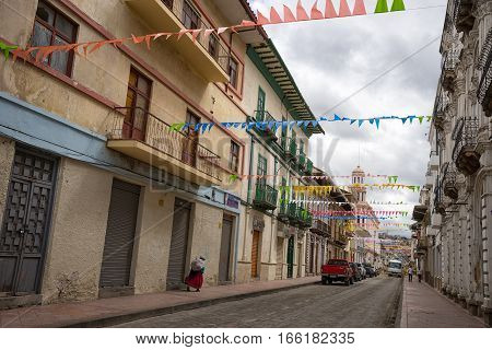 July 10 2016 Cuenca Ecuador: an indigenous woman walks on the street of the colonial town