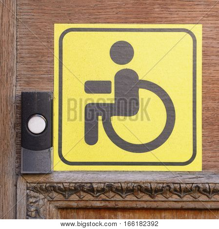 A warning sign for the disabled on the door.That would enter the door - you need to call.