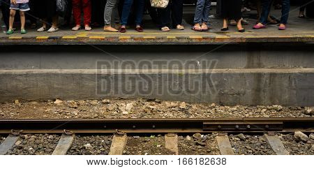 People waiting for train beside railway photo taken in Jakarta Indonesia java