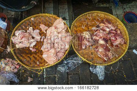 Filleting chicken breast and put on bamboo basket photo taken in Pasar Minggu Jakarta Indonesia java