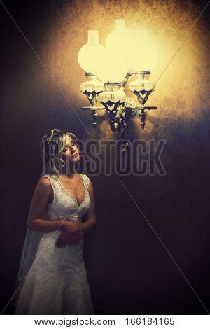 Light Of Vintage Chandelier Illuminates A Pretty Bride