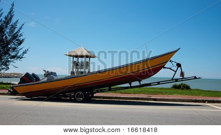 a photo of a boat on a trailor