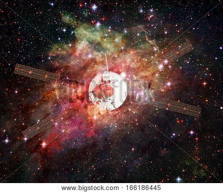 Spaceship in a nebula. Elements of this image furnished by NASA