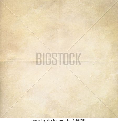 Vintage grunge background paper design with folds and wrinkles in brown and cream. Simple monochrome texture pattern.