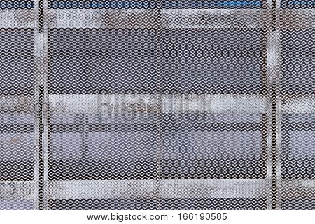 Metal mesh. Wall of metal mesh. Metal structure of the bars and mesh. Metal grid.