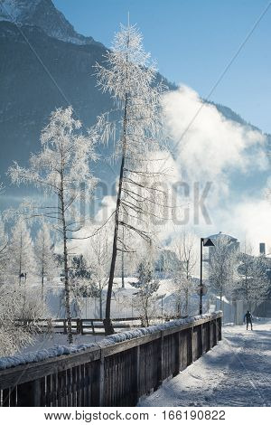 the fine winter mountains landscape. Sunny day. Winter decline. The bright colors. Winter forest. forest road. Branches in hoarfrost.