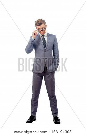 Young Man In A Business Suit Wearing Glasses