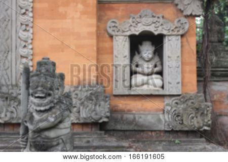 blurred Stone Balinese sculpture. Bali island, Indonesia. Religion statue in taman mini indonesia indah