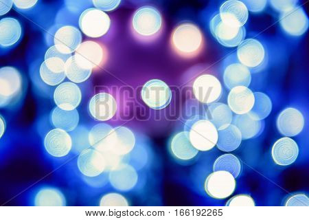 Blue Festive Christmas elegant abstract background with bokeh lights.