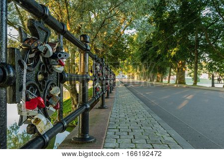 Bridge of lovers on a park alley. Locks of loving hearts