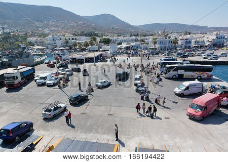 PAROS, GREECE, SEPTEMBER 17, 2016: Passengers and cars disembark from the ship at the port of Paros in Greece. Paros is a beautiful Cycladic island visited by too many tourists every year.