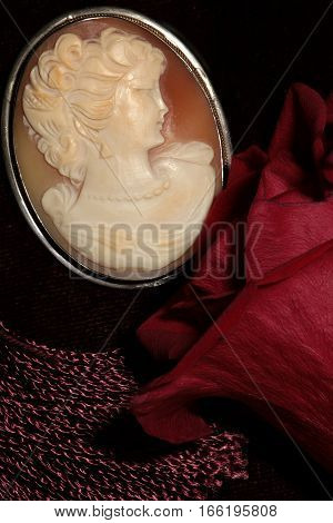cameo female face profile medallion jewelry macro shot