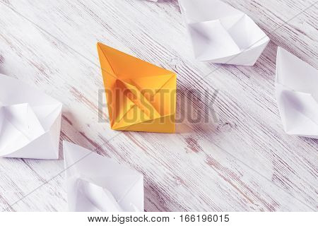 Set of origami boats on wooden table