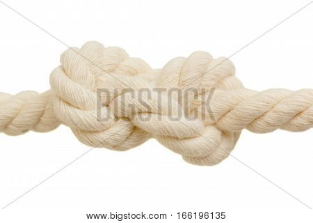 detail of eight shaped knot on natural rope