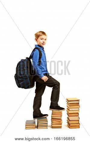 Education concept. A boy climbing the stairs of books Isolated on white.