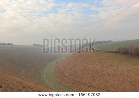 English winter landscape with a misty valley on the scenic Yorkshire wolds in january