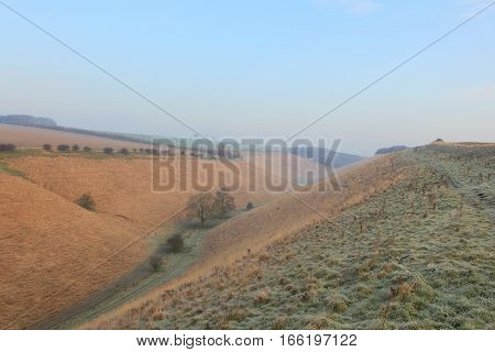 English winter landscape looking down a frozen grassy valley in the scenic countryside of the Yorkshire wolds in January