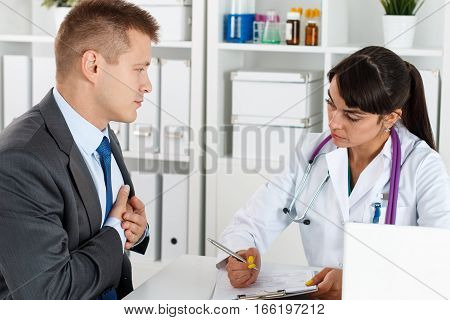 Concerned Beautiful Female Doctor Listen Carefully Businessman Patient Complaints