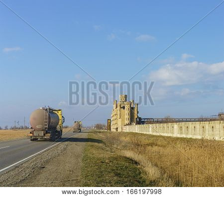 RUSSIA TAMAN PENINSULA TEMRYUK DISTRICT - January 04.2017: Tanker trucks driving on the road along the seaside of the hotel complex is stylized as a medieval castle