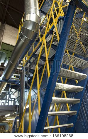 stairs with grate boiler to the boiler room and other parts of the boiler construction