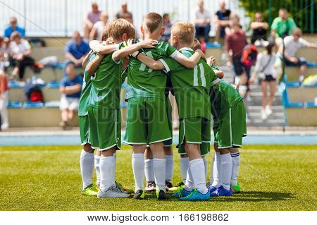 Children's Football Team on the Pitch. Boys in Green Soccer Jersey Shirts Standing Together on the Football Field. Motivated Young Soccer Players Before the Final Game of School Tournament