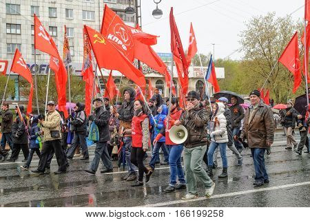 Tyumen, Russia - May 9. 2015: Parade of Victory Day in Tyumen. Members of Commubist Party of Russian Federation on parade