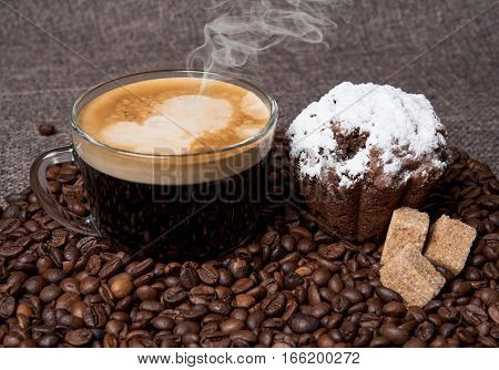 mug of hot black coffee with muffin