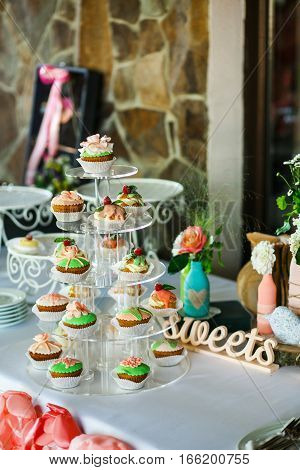 The cakes and candies on the banquet
