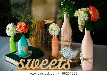 The Vases With Flowers Are On The Banquet