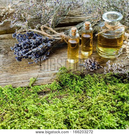 Bunch Of Dry Lavender And Bottle With Aromatic Oil.