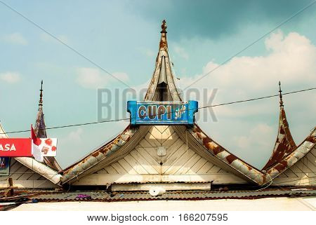 Bukittinggi, Indonesia - traditional pointy roofs close to Jam Gadang and market