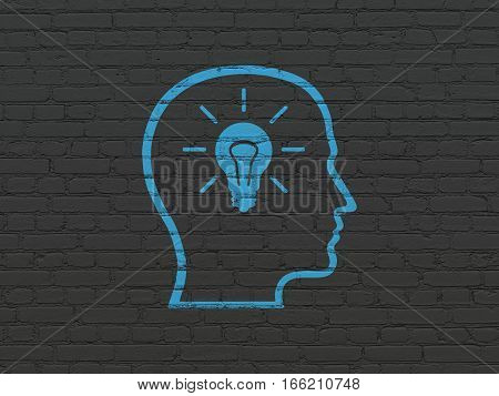 Learning concept: Painted blue Head With Lightbulb icon on Black Brick wall background