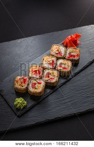 Japanese food hot roll with tuna on black background