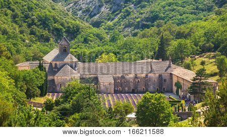 Beautiful landscape lavender field and an ancient monastery Abbaye Notre-Dame de Senanque, Notre-Dame de Senanque abbey, in Vaucluse, France. Top view.