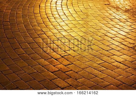 Golden brick circle shaped pavement road in the park