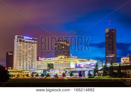 Vilnius, Lithuania - July 7, 2016: Night Evening View Of Radisson Blu Hotel and shopping centre Vilnius Central Department Store VCUP in Vilnius, Lithuania.