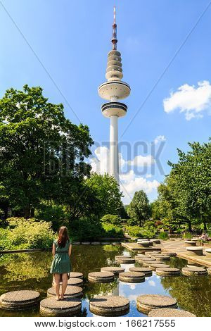 Girl In The Front Of The Heinrich Hertz Tower In Hamburg