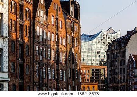 HAMBURG GERMANY - JUNE 6 2016: Typical view to the Speicherstadt from the Holzbrucke Bridge at Nikolaifleet in Hamburg on June 6 2016. Its a popular harbour quarter for tourists in Hamburg.