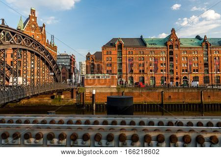 HAMBURG GERMANY - JUNE 6 2016: Typical view of the Speicherstadt also called Hafen City in Hamburg on June 6 2016. Its a popular harbour quarter for tourists in Hamburg.
