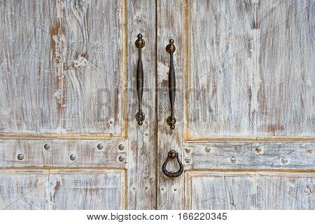 Doorknob and Metal door handle on Vintage white door